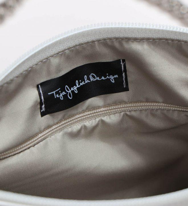 notranjost svetle torbice